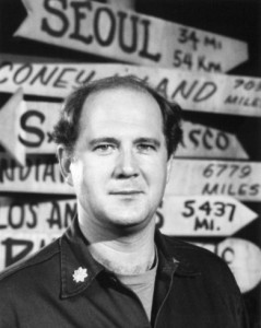 David Ogden Stiers as Major Charles Emerson Winchester III, standing before many different directions.